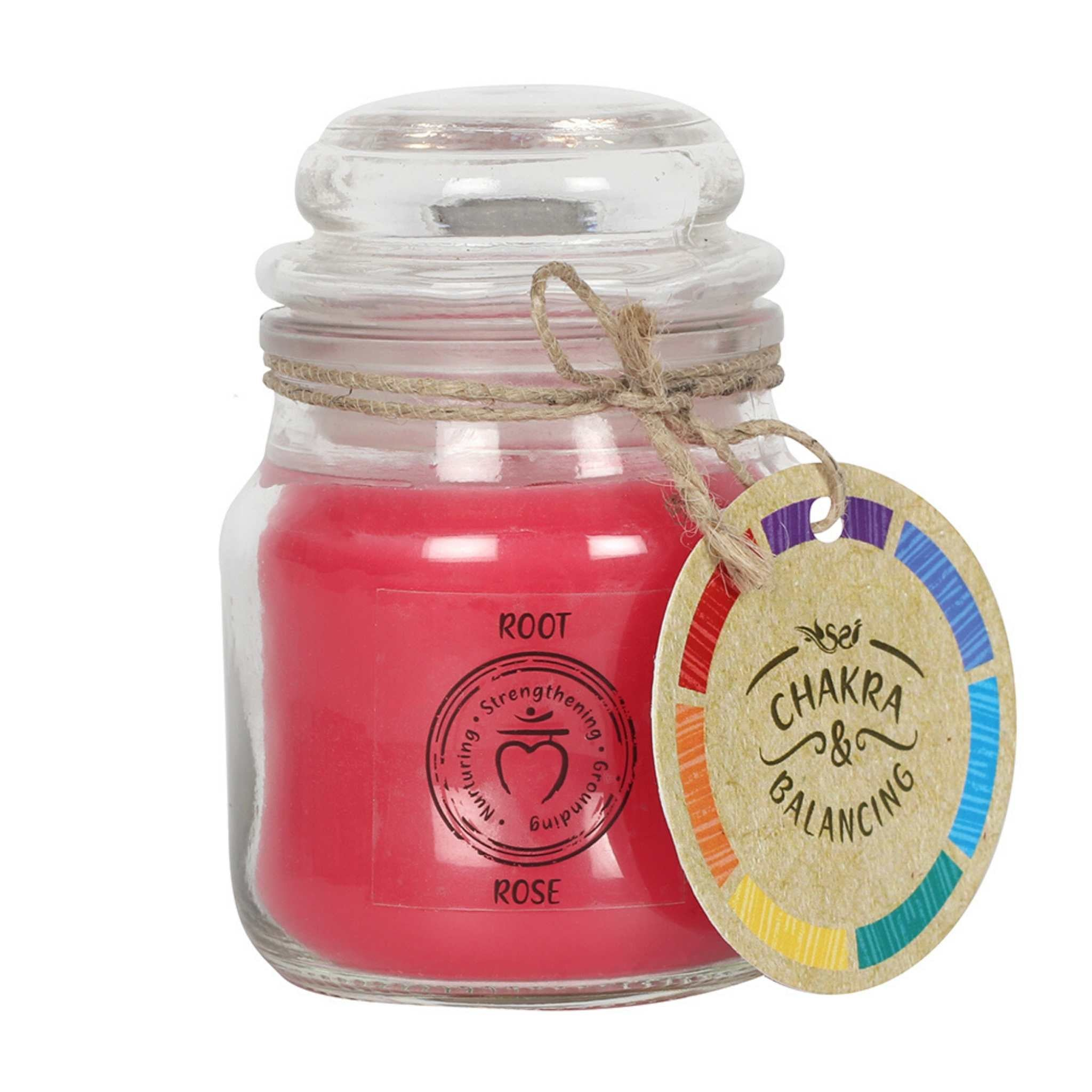 Balancing Chakra Candle in a min glass jar with stopper. Tied with a label that says Chakra Balancing. Candle is red with a label on the jar that says Root - Rose