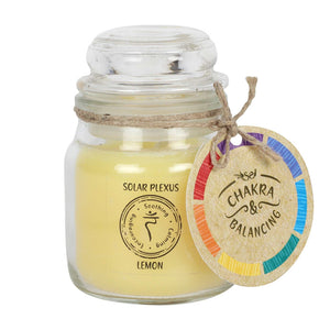 Balancing Chakra Candle in a min glass jar with stopper. Tied with a label that says Chakra Balancing. Candle iscream with a label on the jar that says Solar Plexus - Lemon