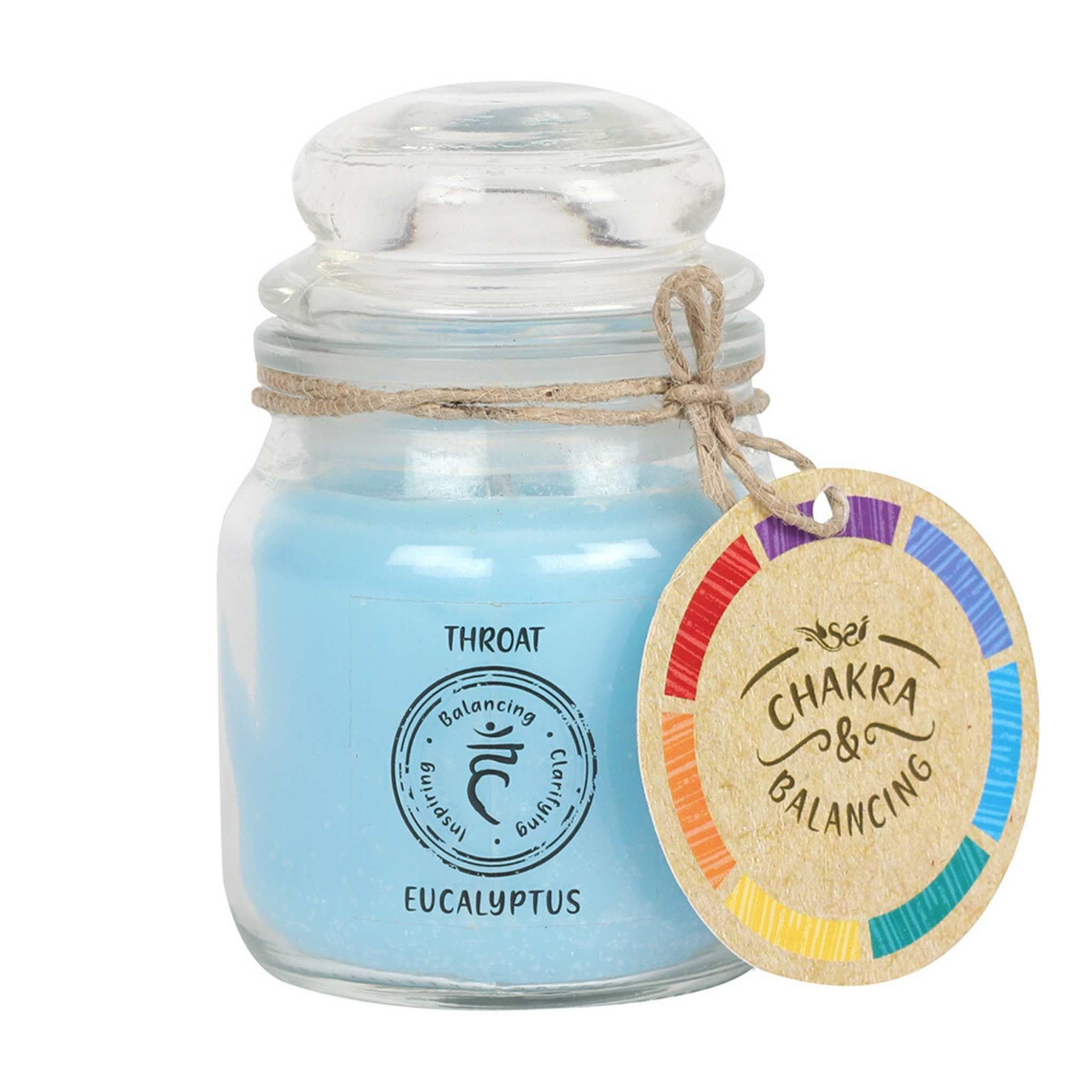 Balancing Chakra Candle in a min glass jar with stopper. Tied with a label that says Chakra Balancing. Candle is blue with a label on the jar that says Throat - Eucalyptus