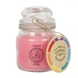Balancing Chakra Candle in a min glass jar with stopper. Tied with a label that says Chakra Balancing. Candle is pink with a label on the jar that says Crown - Lotus
