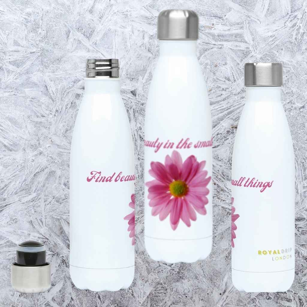 RoyalDrip Naturals Collection -Personalised  Large Pink Daisy on a glossy white aluminium Hydro Flask. Three profiles, front, right and left on a grey marble background. Hydro Flask has pink slogan Find Beauty in the Small things on top of the flower
