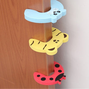 4pcs Cartoon door stop  Baby Child Proofing Door Stoppers Finger Safety Guard (randomly color )