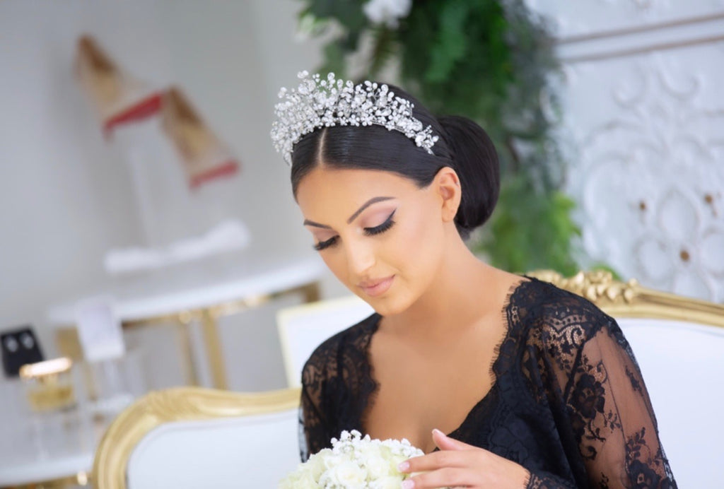 Georgette wearing our Katrina Bridal Crown looking down at her bouquet