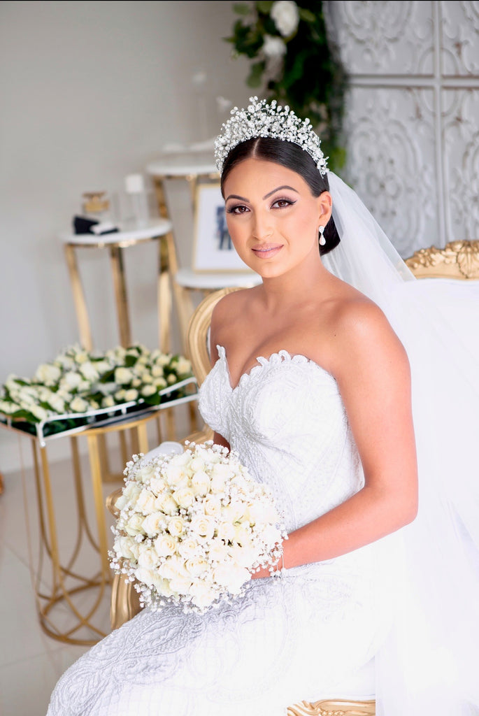 Georgette in her wedding ensemble wearing our Katrina Crown holding her bouquet