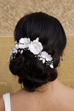 Load image into Gallery viewer, Black haired bride wears a white bridal clip in front of a sandstone wall
