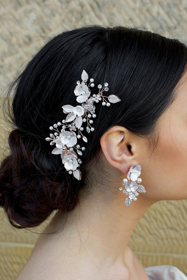 Pale Rose Gold Hair Clip with pearl flowers shown on dark hair