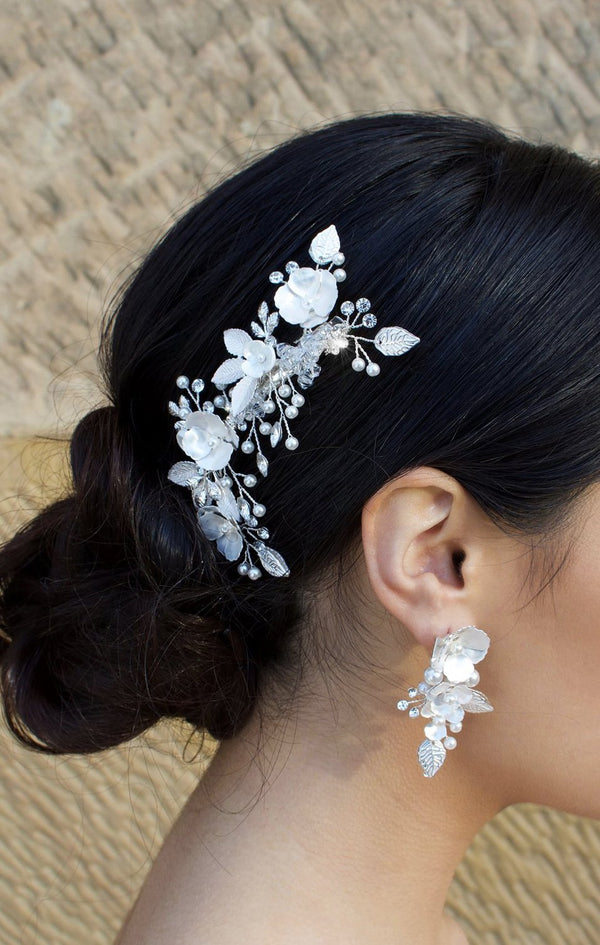 Silver and pearl hair comb with clip fitting with matching earring on dark hair
