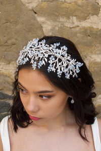 Silver Bridal Headband with Swarovski White opal beads worn on a dark hair bride