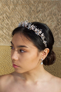Low Bridal Crown in Rose Gold with pearls and stones worn by dark haired model