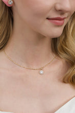 Load image into Gallery viewer, A gold chain around the neck of a model with a single hanging stone