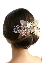 Load image into Gallery viewer, A model with brown hair wears a rose gold and filigree leaves Bridal Vine at the back of her head against a white background