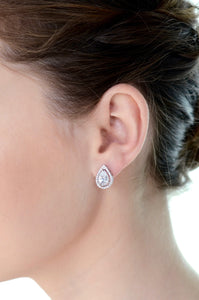 Model wears a teardrop shape stud earring