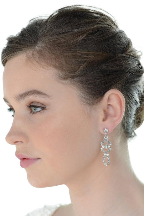 Beautiful short brown hair bride wearing a mid length drop earring with a white background