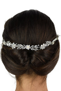 Back of a dark models head who is wearing a simple single strand Bridal Vine with a white background