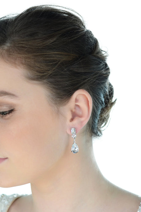 Short Crystal handmade earring worn by a dark hair bride with a white background