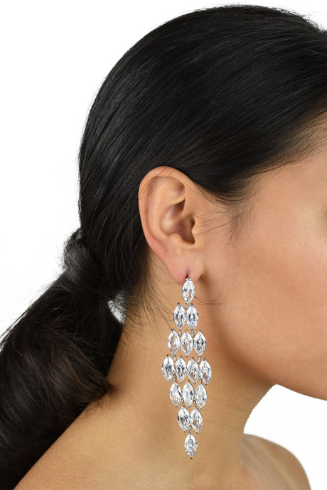 Long Bridal Earrings with Zirconia stones shown on a dark haired Bride