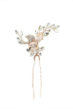 Load image into Gallery viewer, A pale Rose Gold Hairpin with lots of tiny crystals is pictured on a white background