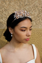 Load image into Gallery viewer, A black haired model wears a rose gold tiara with pearls in the background is a  wall.