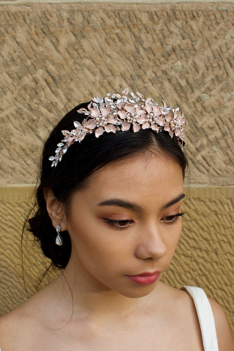 Pale Rose Gold Flowers and Leaves Tiara with pearls worn by a dark hair bride in front of a stone wall