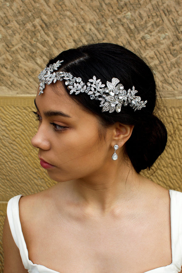 Long Bridal Vine covered in tiny crystals worn by a dark hair model