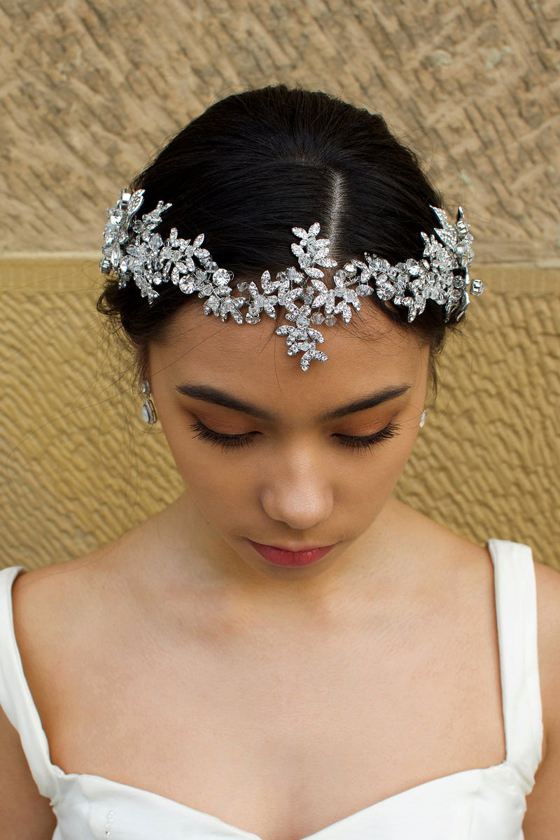 Long Bridal Vine in Dark Silver and crystal worn on the front of a Brides head in front of a stone wall