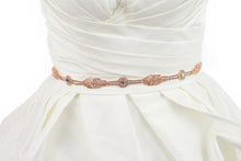 Load image into Gallery viewer, A rose gold narrow bridal belt worn on an ivory bridal gown