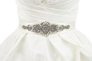 A short wide bridal belt worn on a bridal dress