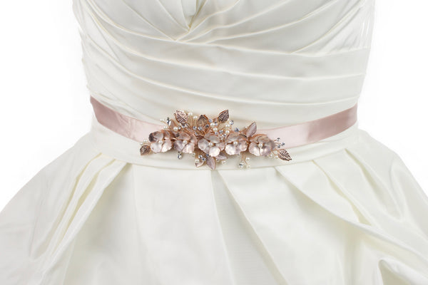 Soft Rose Gold Flowers on a dusty pink satin ribbon bridal belt worn on an ivory bridal gown
