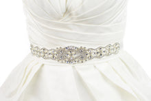 Load image into Gallery viewer, belt on a bridal dress with crystals and pearls on an ivory ribbon on an ivory bridal gown
