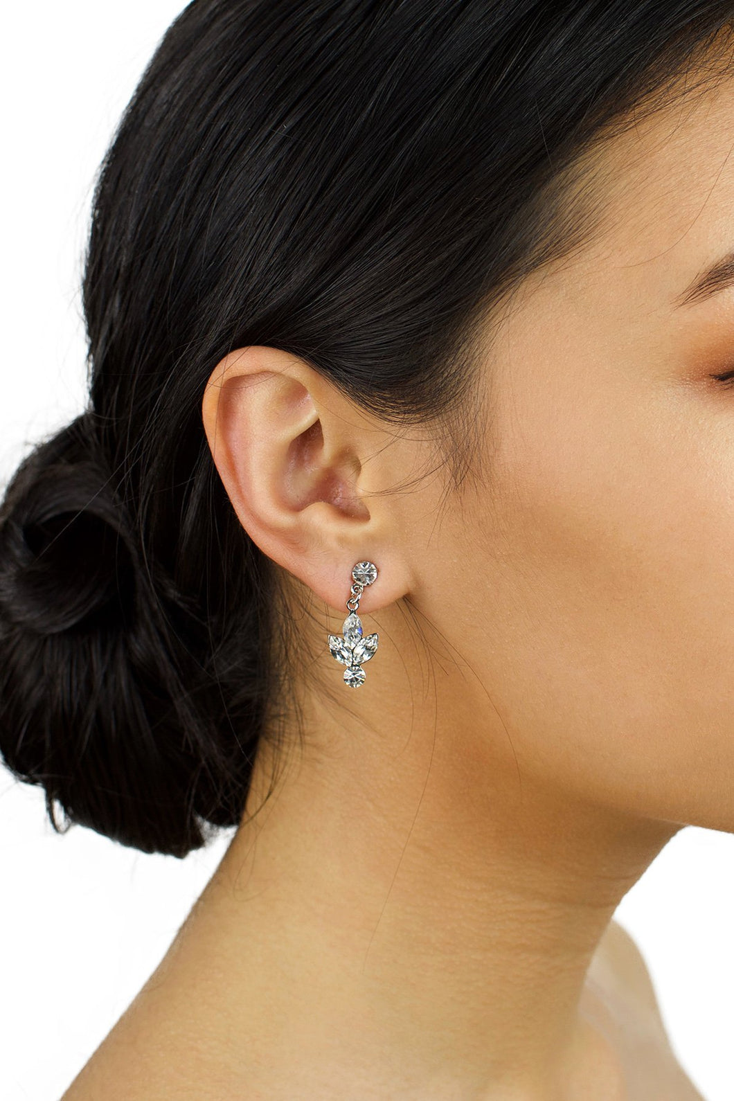 Small handmade Swarovski Earring worn by a bride with up style hair