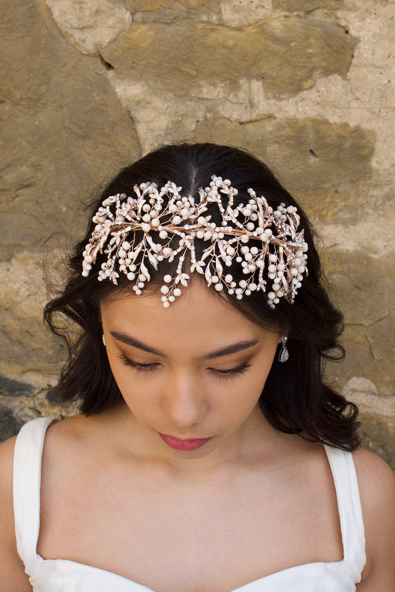 Rose Gold Bridal Headband with coral colour beads worn at the front of a brides head