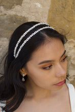 Load image into Gallery viewer, Black hair bride wearing a simple two row silver headband with a stone wall background.