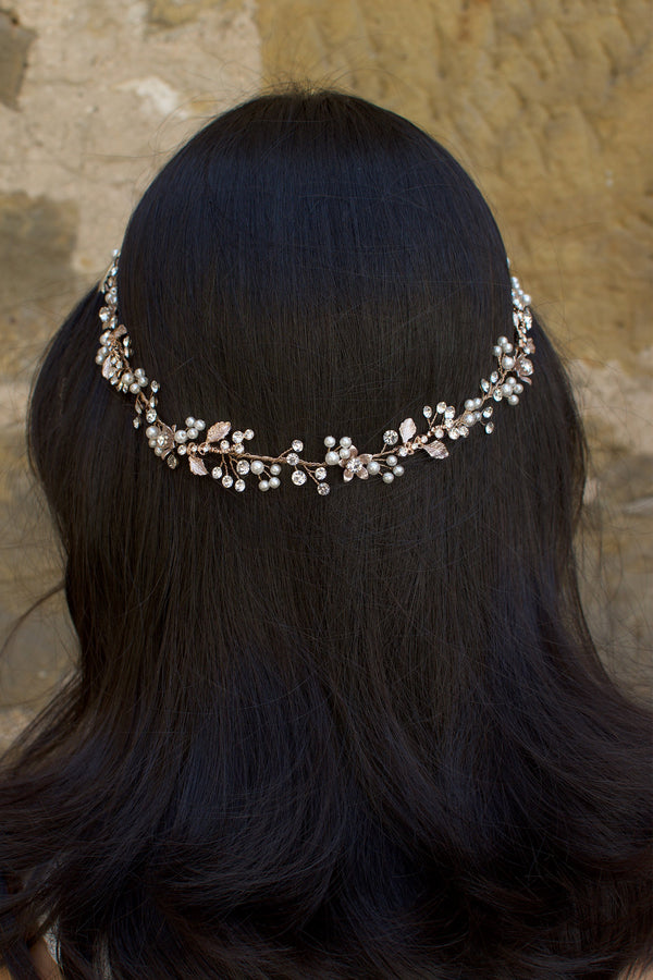 Rose Gold Vine with crystals and pearls on the back of the head of a dark hair model