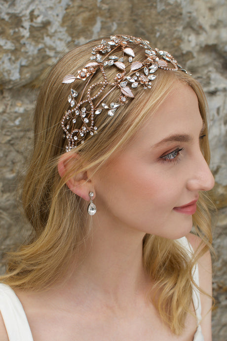 Rose Gold wide headband with clear stones worn by a blonde model