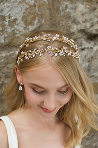 Smiling Blonde Bride wears a headband in gold with a stone wall backdrop