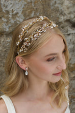 Load image into Gallery viewer, Blonde Bride wearing a Pale gold headband with a stones background