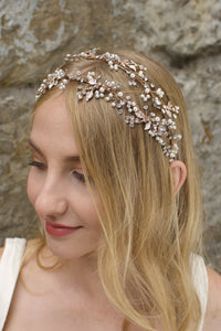 Smiling model wears a double row headband in pearl rose gold on her blonde hair