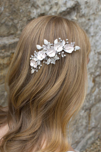 Pale Pink flower side comb worn by a blonde model bride