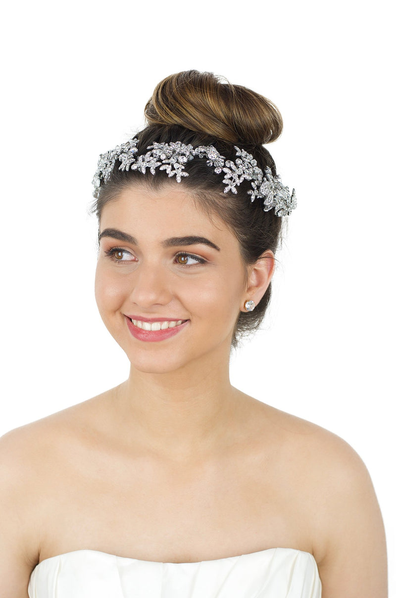 Brown eye Brown hair smiling model wearing long silver bridal vine with white backdrop