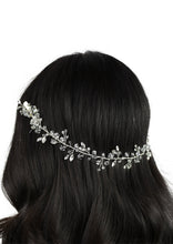 Load image into Gallery viewer, single row of crystals on a silver wire worn on dark hair with a white background