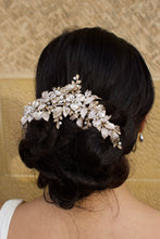 Load image into Gallery viewer, A wide Bridal Headpiece of gold leaves at the back of a model's head with a stone wall backdrop