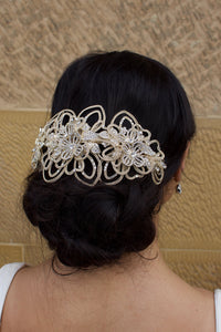 A very wide Matt Gold Bridal Headpiece worn at the back of the head by a dark hair bride