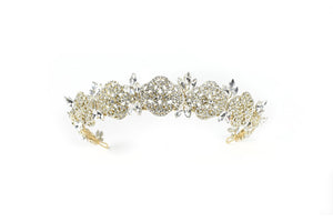 A Pale Gold crown against a bright white background. It has a full cover of tiny crystals