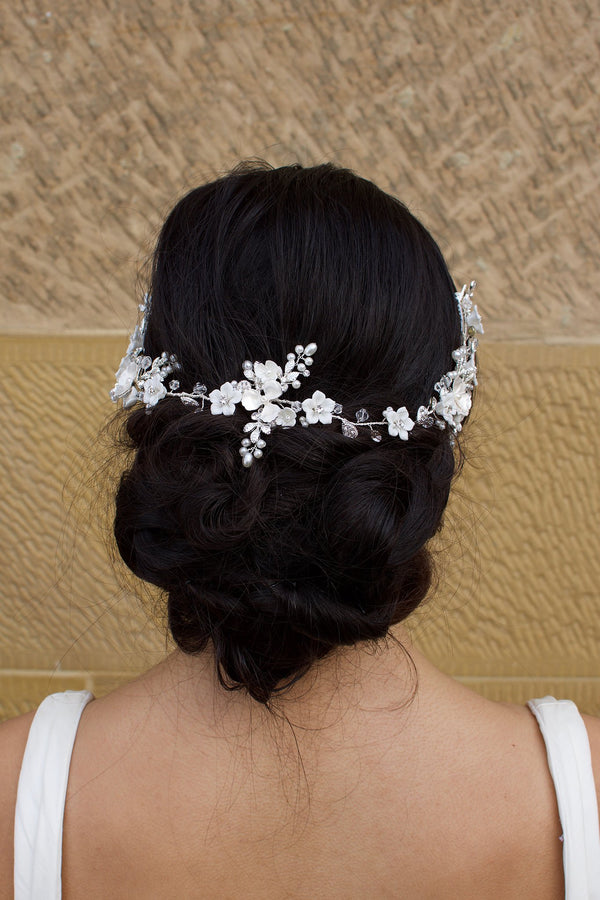 Silver and pearl bridal vine worn on the back of a brides head