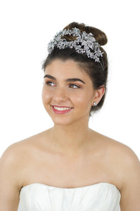 Wide Headband encrusted with many tiny stones worn by a beautiful bride