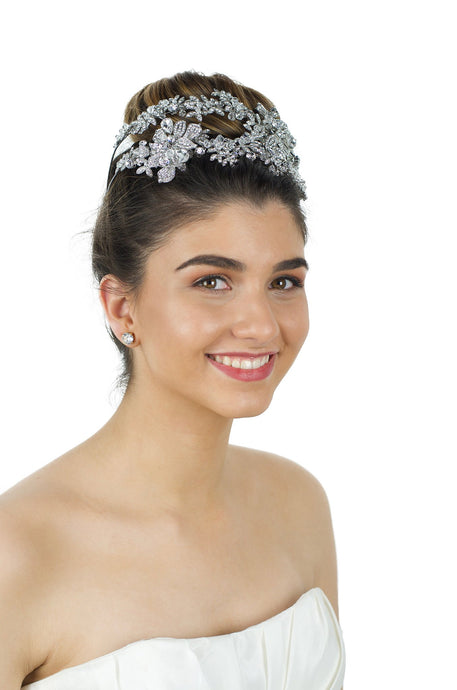 Double row wide Bridal Headband covered in hundreds of tiny stones worn by a smiling beautiful bride