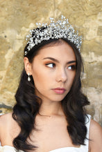 Load image into Gallery viewer, A Bride wears a high Tiara of pearls and Swarovski Crystals on her dark hair