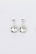 Load image into Gallery viewer, Bright Silver earring in a pear shape with clear swarovski stones