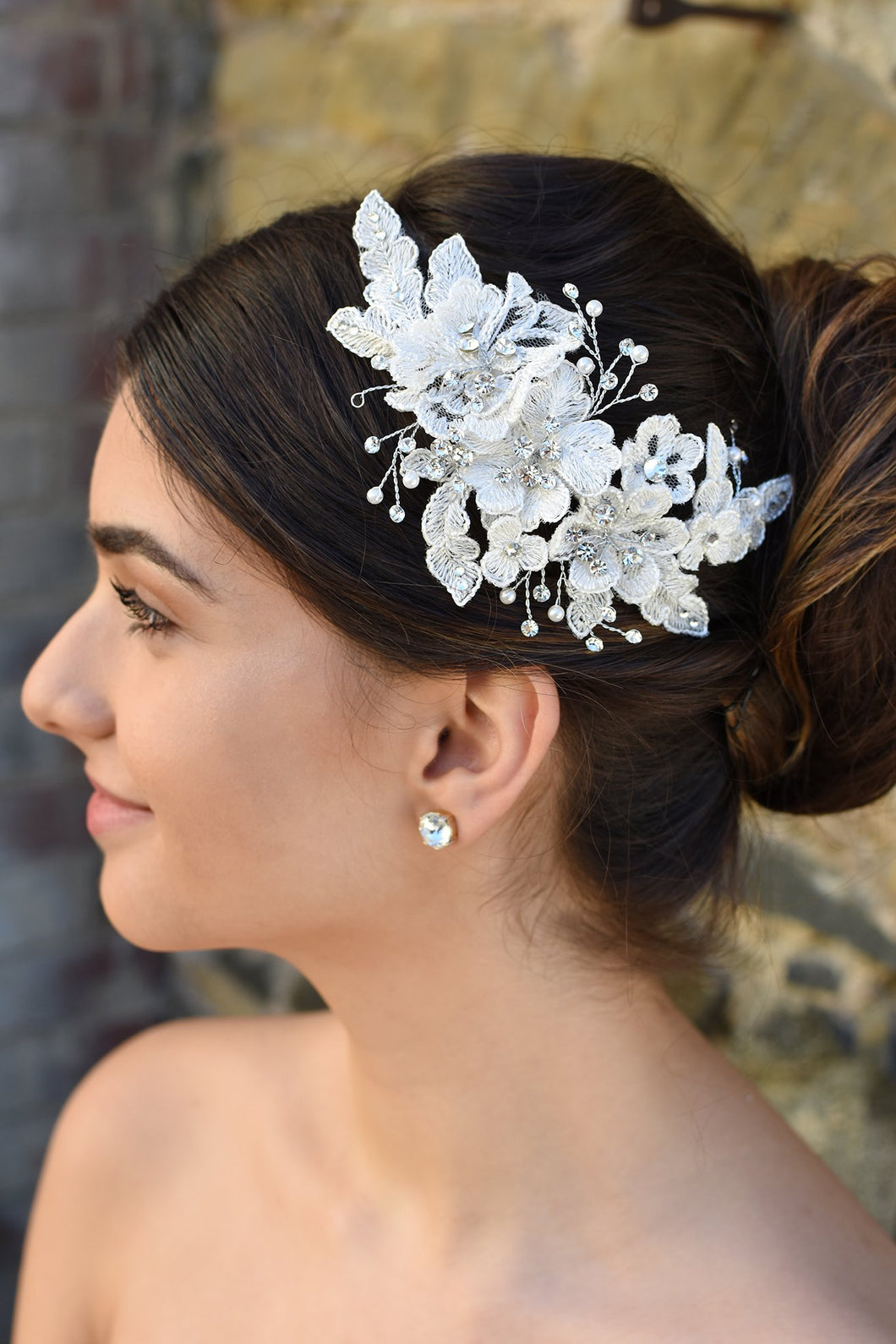 Lace and Silver side comb with pearl shown on lovely Bride