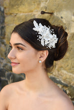 Load image into Gallery viewer, White Lace Bridal side comb with a few stones and pearls shown on popular Bridal hairstyle